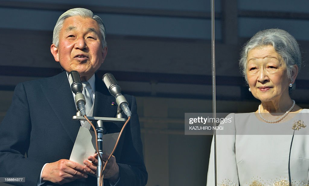 Japanese Emperor Akihito (L), accompanied by Empress Michiko (R), delivers a speech to well-wishers gathered at the Imperial Palace in Tokyo on January 2, 2013 during the annual New Year's greetings. Japan's Emperor Akihito and his family greeted well-wishers in customary New Year public appearances.