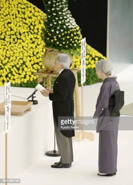 Japanese Emperor Akihito alongside Empress Michiko delivers a speech during a ceremony in Tokyo on Aug 15 the 72nd anniversary of Japan's surrender...