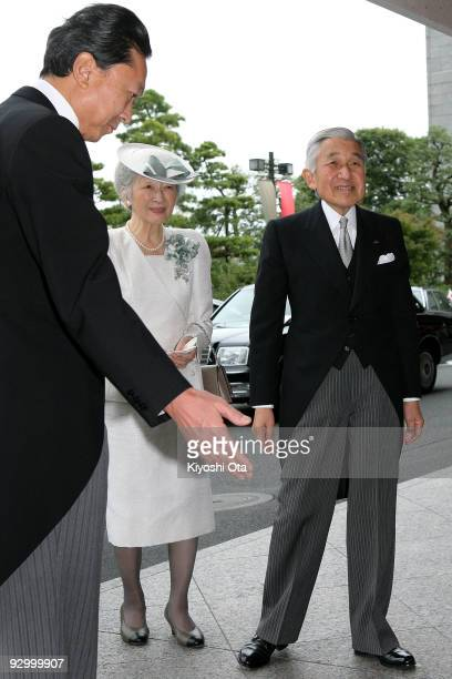 Japanese Emperor Akihito and Empress Michiko are escorted by Japanese Prime Minister Yukio Hatoyama upon their arrival at the memorial ceremony in...