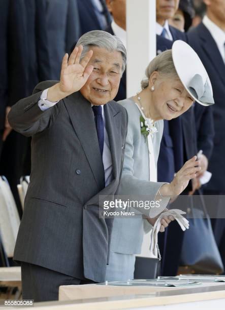 Japanese Emperor Akihito and Empress Michiko arrive at Ehime Prefectural Sports Complex in Matsuyama western Japan on Sept 30 to attend the opening...