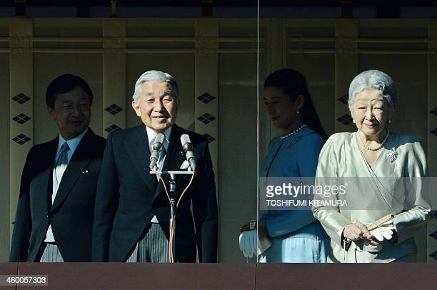 Japanese Emperor Akihito and Empress Michiko greet wellwishers while Crown Prince Naruhito and Crown Princess Masako walk behind at the Imperial...