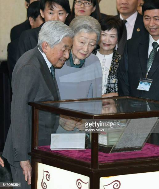 Japanese Emperor Akihito and Empress Michiko look at a specimen of the goby fish discovered by the emperor as a new species in the 1970s at the...