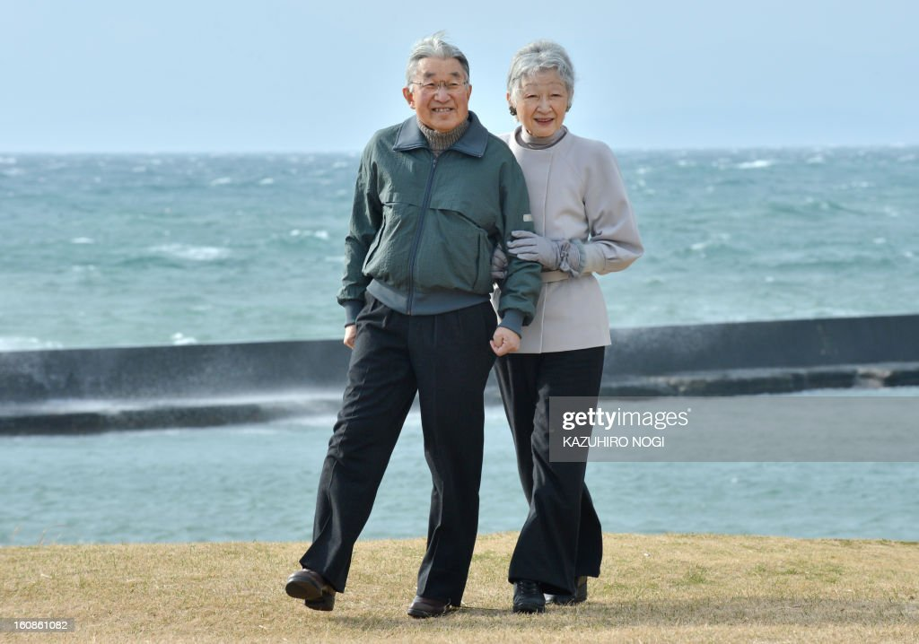 Japanese Emperor Akihito (L) and Empress Michiko (R) stroll around the imperial villa in Hayama, in Kanagawa prefecture south of Tokyo on February 7, 2013. The emperor and empress arrived here on February 7 for a rest until February 10.