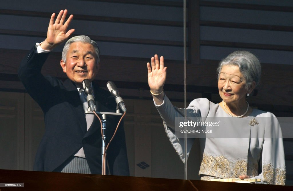 Japanese Emperor Akihito (L) and Empress Michiko (R) wave to well-wishers gathered at the Imperial Palace in Tokyo on January 2, 2013 during the annual New Year's greetings. Emperor Akihito and his family received greetings from well-wishers at Imperial Palace.