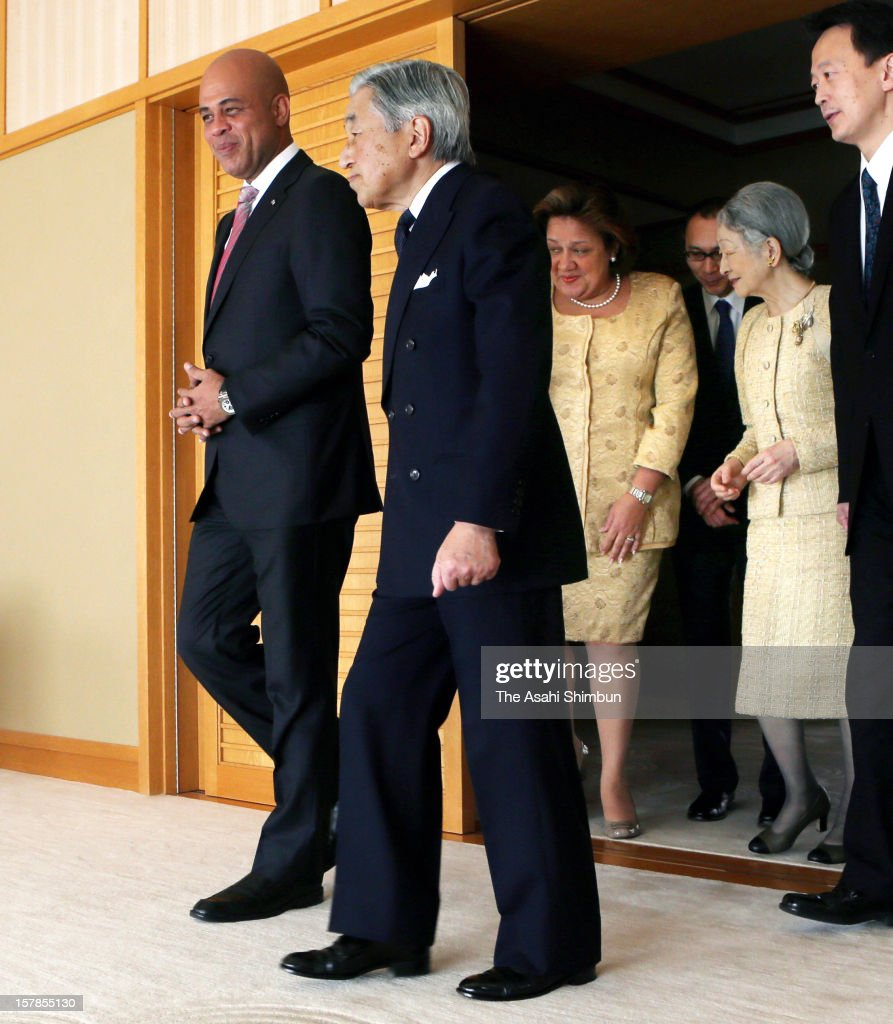 Japanese Emperor Akihito (2L) and Haiti President <a gi-track='captionPersonalityLinkClicked' href=/galleries/search?phrase=Michel+Martelly&family=editorial&specificpeople=7130974 ng-click='$event.stopPropagation()'>Michel Martelly</a> (1L) walk in a room while Empress Michiko (2R) and Sophia Martelly (3L) follow at the Imperial House on December 7, 2012 in Tokyo, Japan.