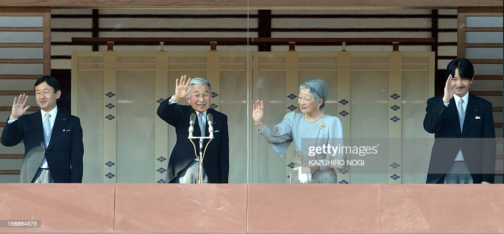 Japanese Emperor Akihito (2nd L), Empress Michiko (2nd R), Crown Prince Naruhito (L) and Prince Akishino (R) wave to well-wishers (not pictured) gathered at the Imperial Palace in Tokyo on January 2, 2013. Japan's Emperor Akihito and his family greeted well-wishers in customary New Year public appearances.