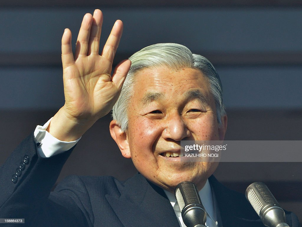 Japanese Emperor Akihito waves to well-wishers gathered at the Imperial Palace in Tokyo on January 2, 2013. Japan's Emperor Akihito and his family greeted well-wishers in customary New Year public appearances.