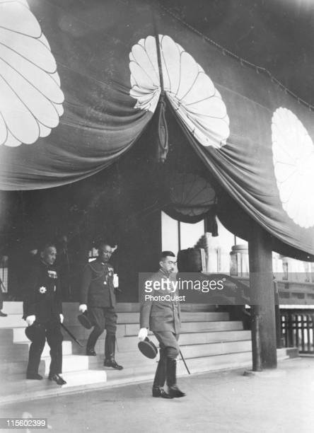 Japanese Emperor Hirohito leaves the Yasukuni Shrine where he paid tribute to the Japanese soldiers who died in Chinese campaign Tokyo Japan November...