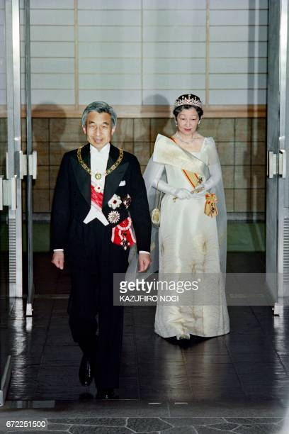 Japanese Empress Michiko and Emperor Akihito walk out of the entrance of the Alaska Palace before attending the rite of audience on June 9 1993 / AFP...