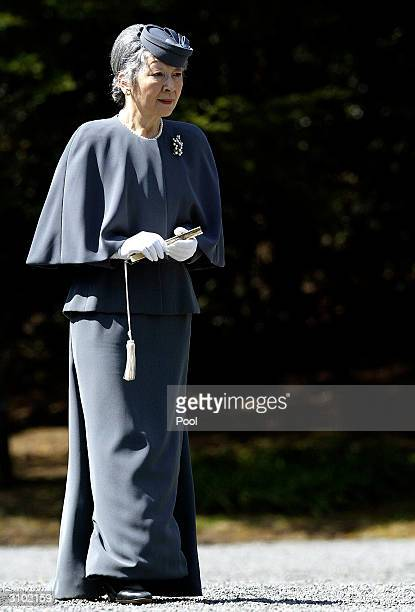 Japanese Empress Michiko arrives at the Imperial graves of Emperor Akihito's father and mother on March 17 2004 in Tokyo Japan Japan's Royal couple...