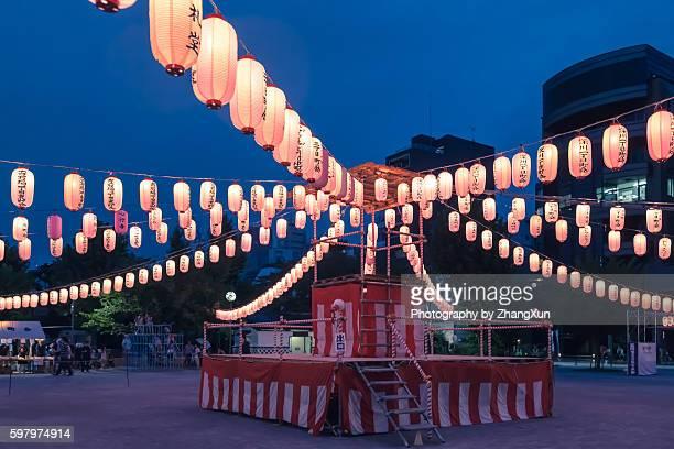 Japanese enjoying a traditional dance named Obon Odori at summer night