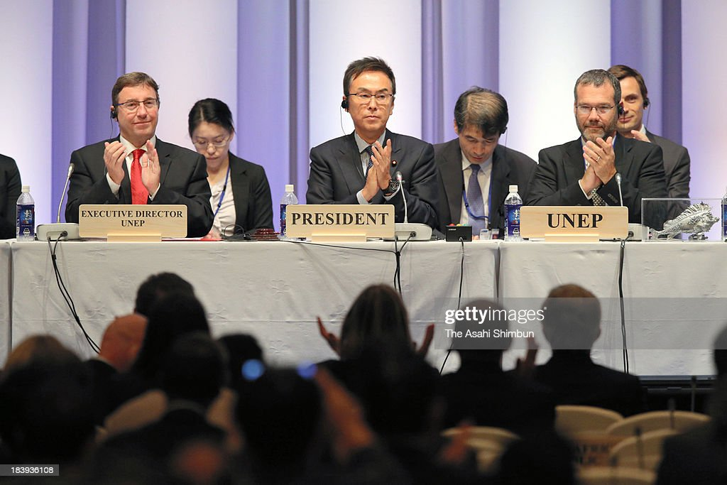 Japanese Environment Minister and chair of the conference <a gi-track='captionPersonalityLinkClicked' href=/galleries/search?phrase=Nobuteru+Ishihara&family=editorial&specificpeople=2258645 ng-click='$event.stopPropagation()'>Nobuteru Ishihara</a> (C) applauds after adopting the Minamata Convention on Mercury during the at the Conference of Plenipotentiaries on the Minamata Convention on Mercury on October 10, 2013 in Kumamoto, Japan. The convention not only bans the new development of mercury mines but also comprehensively regulates the trade in and use of mercury for industrial and mining purposes as well as its emissions.