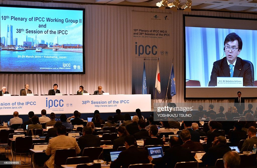 Japanese Environment Minister Nobuteru Ishihara (back 3rd L) delivers an opening speech at the opening session of the 10th plenary of the Intergovernmental Panel on Climate Change (IPCC) Working Group II in Yokohama, suburban Tokyo on March 25, 2014. International scientists gathered near Tokyo for a week-long meeting centred on a grim climate change report that warned of floods and drought that could stoke conflicts and wreak havoc on the global economy. AFP PHOTO / Yoshikazu TSUNO