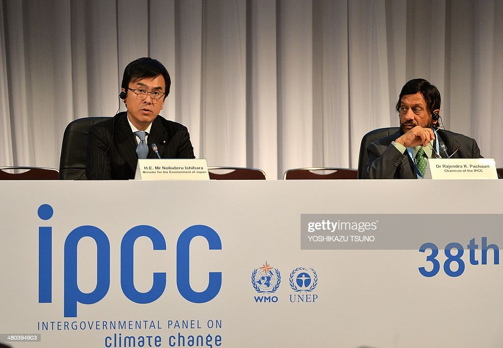 Japanese Environment Minister Nobuteru Ishihara (L) delivers an opening speech while Rajendra Pachauri (R), chair of the Intergovernmental Panel on Climate Change (IPCC) looks on at the opening session of the tenth plenary of the IPCC Working Group II in Yokohama, suburban Tokyo on March 25, 2014. International scientists gathered near Tokyo for a week-long meeting centred on a grim climate change report that warned of floods and drought that could stoke conflicts and wreak havoc on the global economy. AFP PHOTO / Yoshikazu TSUNO