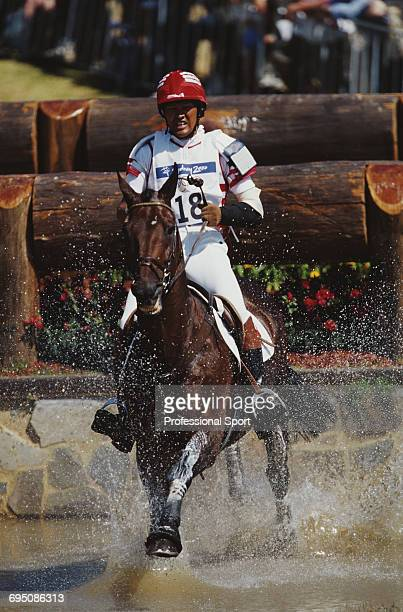 Japanese equestrian Masuru Fuse competes on Voyou Du Roc for the Japan team to finish in joint 10th place in the Team eventing equestrian event at...