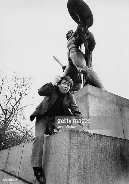 Japanese explorer Naomi Uemura climbs the statue of Achilles in London's Hyde Park February 1979 He is in the capital to receive the International...