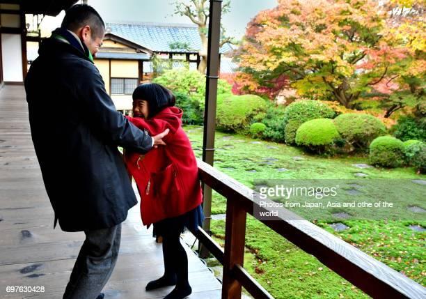 Japanese Family Appreciating Japanese Autumn Foliage at Tofuku-ji, Kyoto
