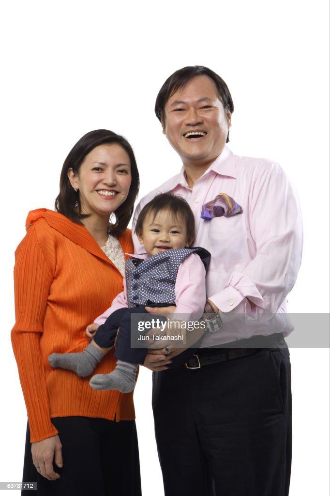 Japanese family looking at camera : Stock Photo