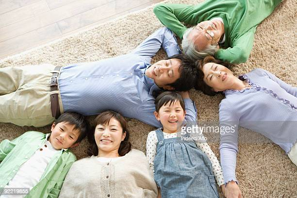 Japanese family lying down on carpet
