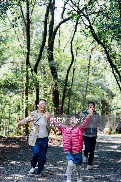 Japanese family running together
