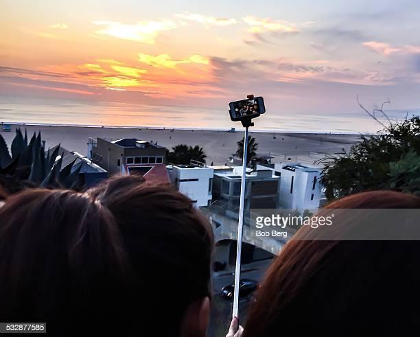 Santa Monica Ca January 9 2014 A Japanese family touring Santa Monica take a family selfie with a selfie stick
