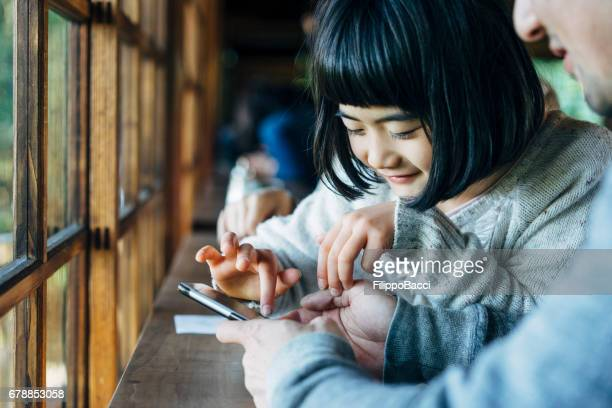 Japanese family using smartphone together