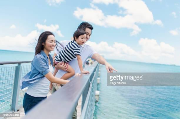 Japanese family walking bridge with smile