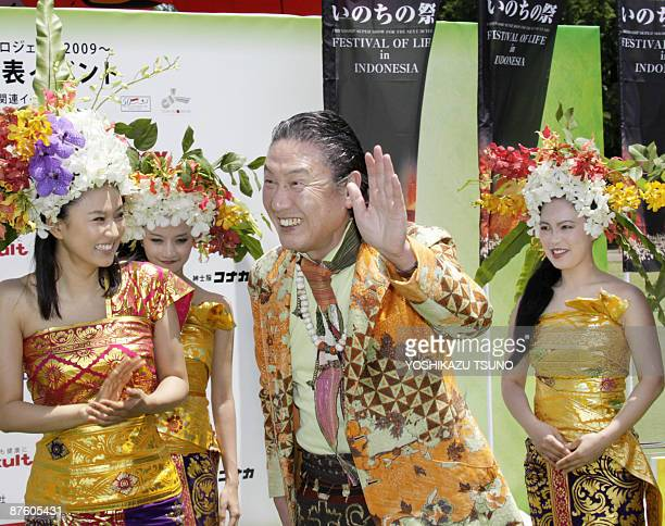 Japanese famous fashion designer and event producer Kansai Yamamoto smiles with Japanese actress Rei Kikukawa and Indonesian models in traditional...