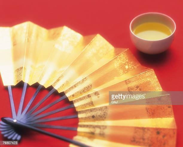 A Japanese fan and a cup of japanese tea, Close Up, High Anlge View
