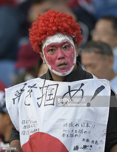 Japanese fan cheers on his team during a Pool B match of the 2015 Rugby World Cup between South Africa and Japan at the Brighton community stadium in...