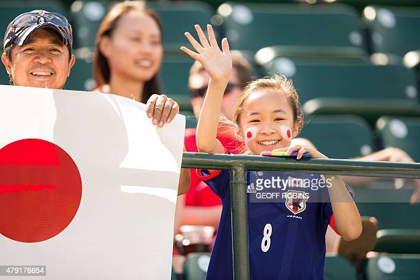 A Japanese fan waves to the players before the start of the semifinal match at the FIFA Women's World Cup between Japan and England at Commonwealth...