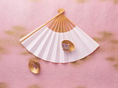 Japanese fan with gold decorated seashells