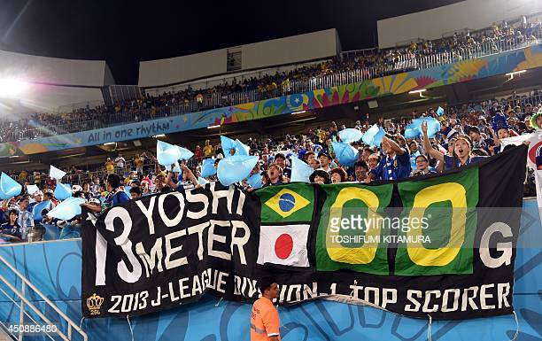 Japanese fans cheer prior to a Group C football match between Japan and Greece at the Dunas Arena in Natal during the 2014 FIFA World Cup on June 19...