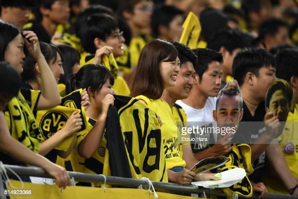 Japanese fans of Burussia Dortmund cheer after the preseason friendly match between Urawa Red Diamonds and Borussia Dortmund at Saitama Stadium on...