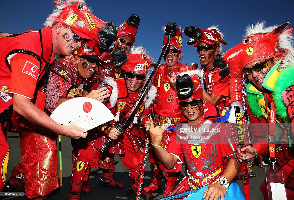 Japanese fans of Ferrari attend the Japanese Formula One Grand Prix at Suzuka Circuit on October 13 2013 in Suzuka Japan