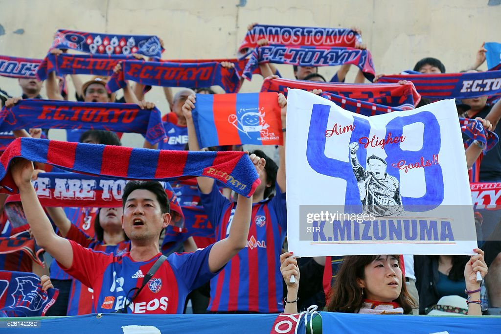 Japanese fans of Japan's FC Tokyo cheer for their team during the AFC Championship Group E football match against Vietnam's Becamex Binh Duong in Thu Dau Mot city, southern province of Binh Duong on May 4, 2016. FC Tokyo won 2-1. / AFP / STR