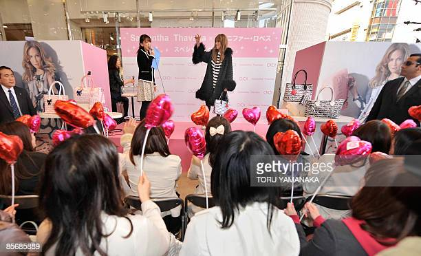Japanese fans wave balloons to welcome US actress and pop singer Jennifer Lopez during her appearance at an event by Japanese fashion company...