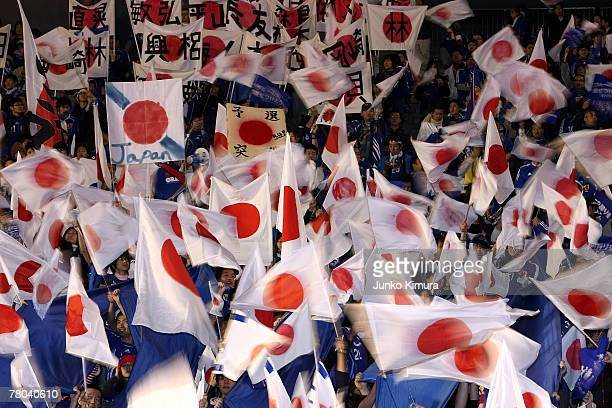 Japanese fans waves flags after the 2008 Beijing Olympic Qualifier final round game between Japan and Saudi Arabia at the National Stadium on...