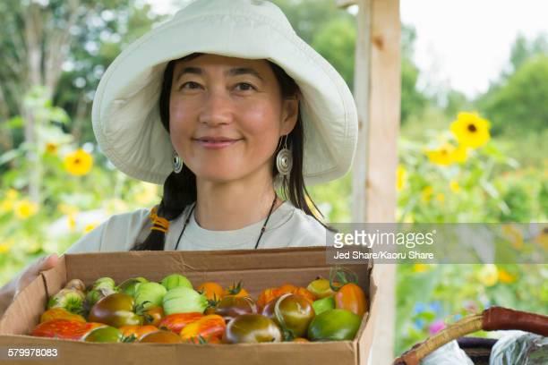 Japanese farmer harvesting produce on farm