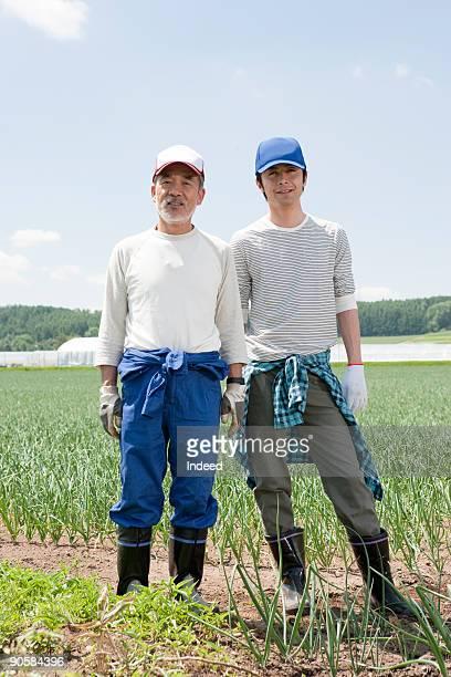 Japanese farmers in field, portrait