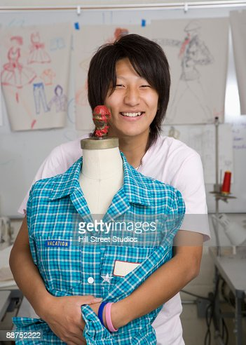 Japanese fashion design student with dressmakers model : Stock Photo