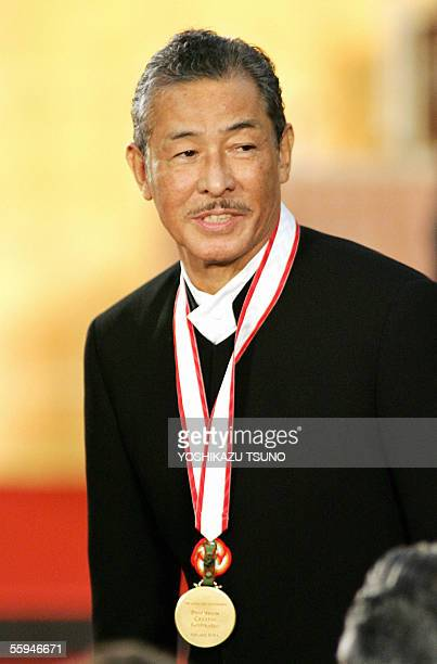Japanese fashion designer Issey Miyake smiles after receiving the gold medal of the Praemium Imperiale at the awarding ceremony in Tokyo 18 October...