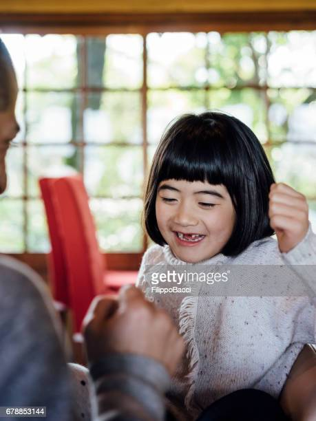 Japanese father and daughter having fun together