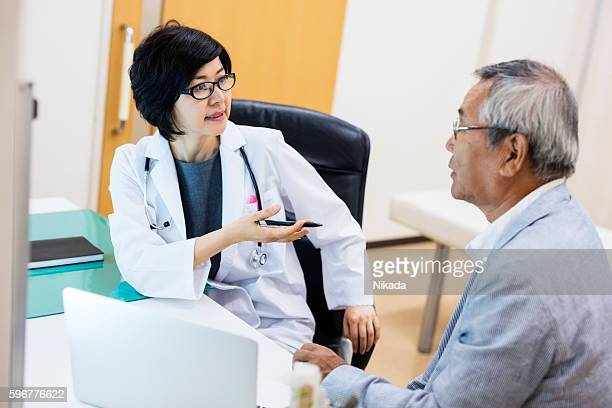 japanese female doctor talking with patient in hospital