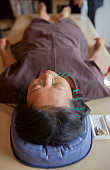 japanese female get acupuncture treatment in kyoto japan