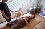 japanese female having acupuncture treatment with expert in kyoto japan