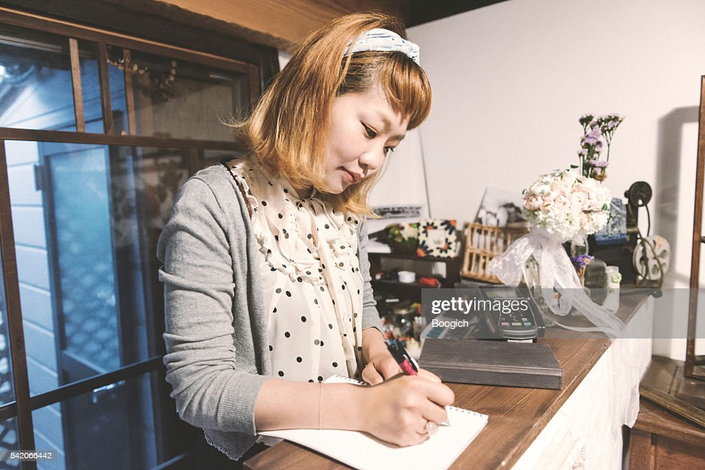 Japanese Female Small Business Owner Writing Daily Accounts Kyoto Japan