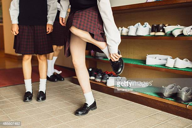 Japanese female students changing shoes at school