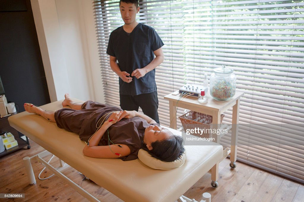 japanese female talking about acupuncture treatment  in kyoto japan