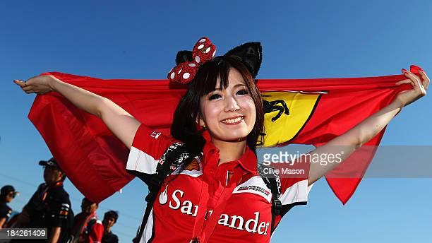 Japanese Ferrari fan attends the Japanese Formula One Grand Prix at Suzuka Circuit on October 13 2013 in Suzuka Japan